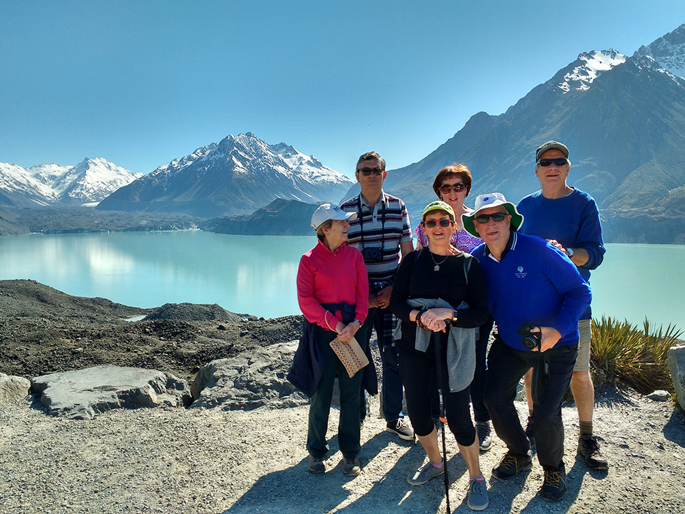 Small group photo overlooking the Tasman Glacier lake