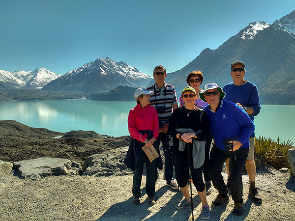 Walkers at the Tasman Glacier Terminal Lake in Aoraki Mt Cook National Park