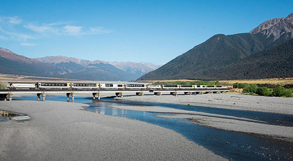 TranzAlpine Train crossing the Waimakariri River - Travel Costs in New Zealand