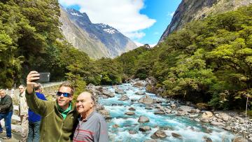 Father and son selfie at the Hollyford River on the Milford Road