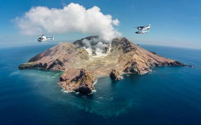 Helicopter and Floatplane flying above the White Island volcano - Rotorua Optional Tour