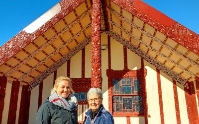 Tourists at a Maori meeting house in Rotorua