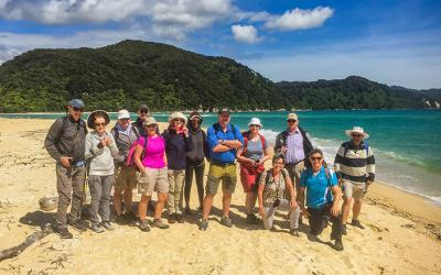 Tour group and guide on the beach at Abel Tasman National Park