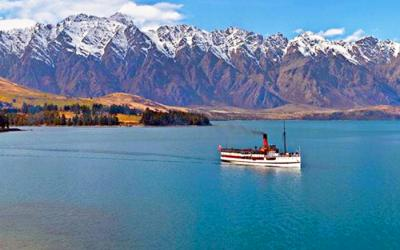 Earnslaw Steamship on Lake Wakatipu with the mountains behind - NZ South Island Tour