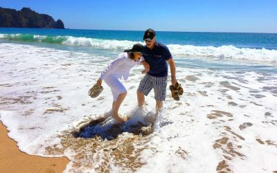 Barefoot in the surf, North & South Island New Zealand Tour