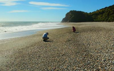 Collecting stones on a remote West Coast beach