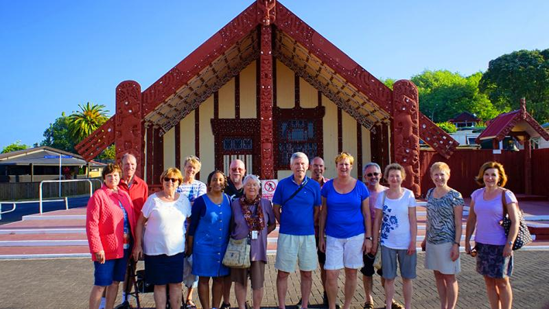 Group outside Ohinemutu Maori meeting house Rotorua - NZ North and South Island Itinerary