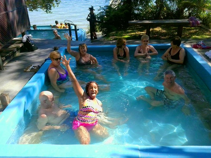 Enjoying a soak in natural hot springs - NZ Small Group Tours