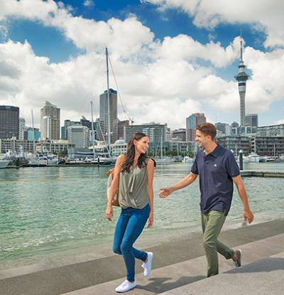 Balanced lifestyle is one reason to move to New Zealand - Couple walking in Auckland