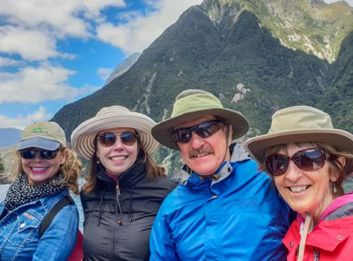 Travellers enjoying spring conditions on their Milford Sound cruise