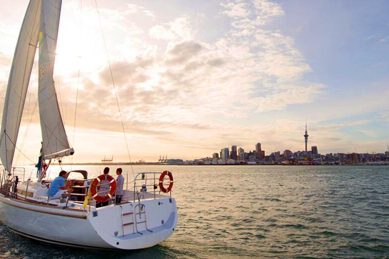 A sail boat on the sea during sunset, Auckland Harbour dinner cruise