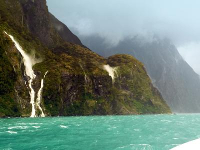 Waterfalls and storm clouds, Milford Sound