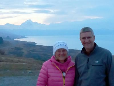 Happy travellers at Lake Pukaki, Mt Cook in the distance