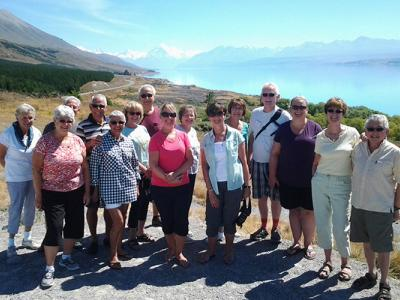 Happy guests beside Lake Tekapo