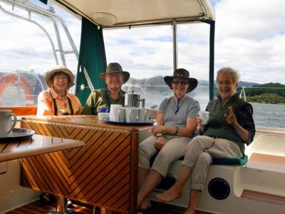 Morning tea and a boat cruise on tour