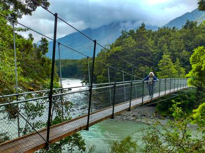 Crossing the swingbridge at Blue Pools Wanaka - MoaTrek Tour Gallery