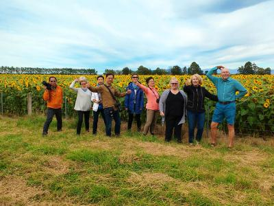Group photo at sunflower field, Canterbury - MoaTrek Tour Gallery February 2017