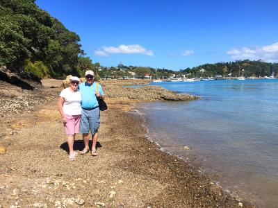 Couple walking by the seaside, Russell, Bay of Islands