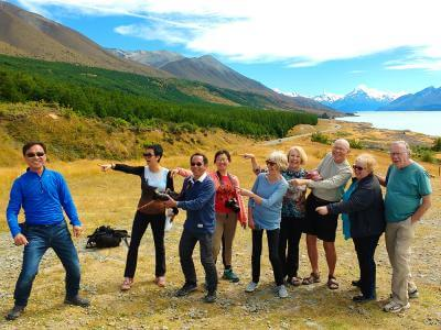 Group of people have fun in front of Lake Pukaki Mt Cook on the winter tour