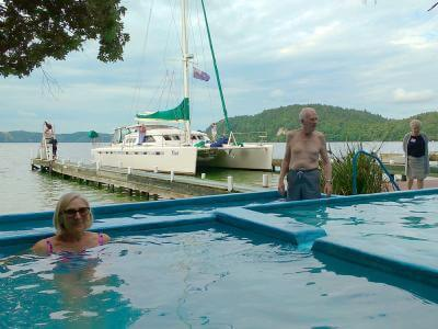 Relaxing in Lake Rotoiti Hot Pools while Catamaran moored on winter tour