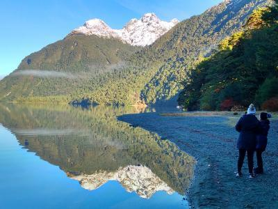 Spectacular lake reflection from Milford Road on the winter tour