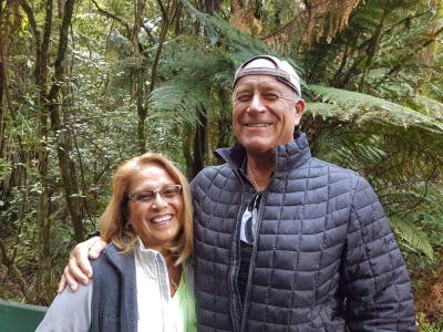 Happy couple walking in the Waipoua forest