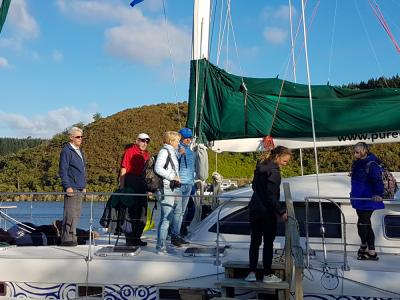 Group onboard the yacht Tuia on Lake Rotoiti