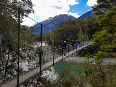 Walkers crossing the swingbridge at the Blue Pools