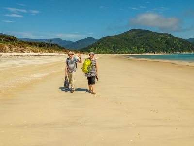 Walking along the stunning beach in the Abel Tasman National Park