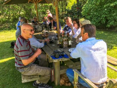 Guests enjoying a Springtime country lunch with hosts Ian and Di at Akaunui Homestead in Canterbury
