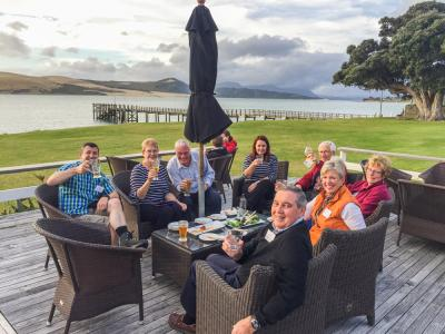 Travellers enjoying drinks on the deck at the Hokianga Harbour
