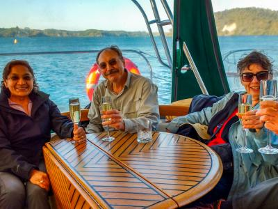 Guests on the Yacht Tuia enjoying drinks on Lake Rotoiti