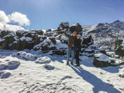 Travellers taking a Selfie in the spring snow at Mount Ruapehu
