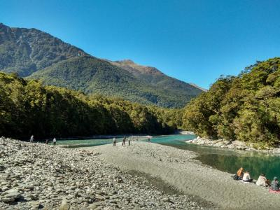 Walkers taking a break by the river, Blue Pools Mt Aspiring National Park
