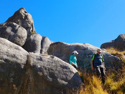 Walkers amongst the Rock Formations at Castle Hill