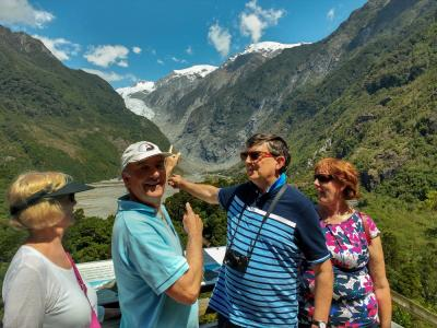 Walkers at the Franz Josef Glacier Lookout on a beautiful day