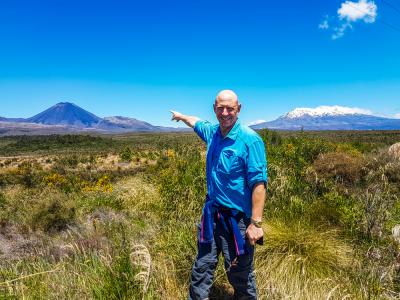 Walker in Tongariro National Park, with Mts Ngauruhoe & Ruapehu in the background