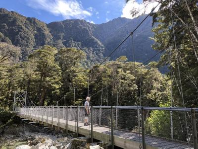 Walker crossing Swingbridge on the Routeburn Track