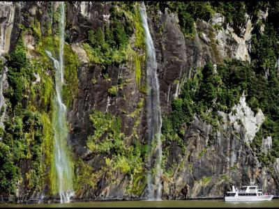 Waterfalls and Cruise Boat in Milford Sound