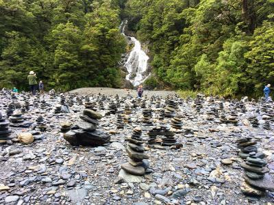 Rock stacks by the Blue Pools waterfall, Mt Aspiring