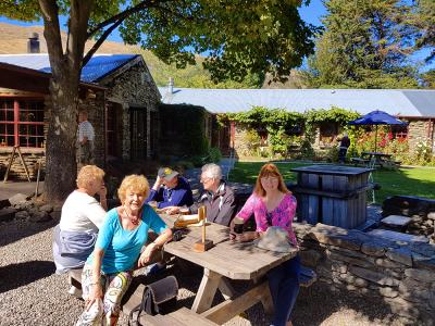 Relaxing in the garden, Cardrona Hotel - MoaTrek Small Group Tours