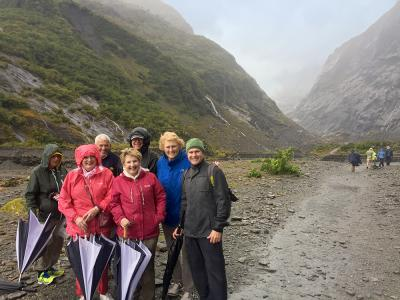 Group and guide walking at Franz Josef Glacier