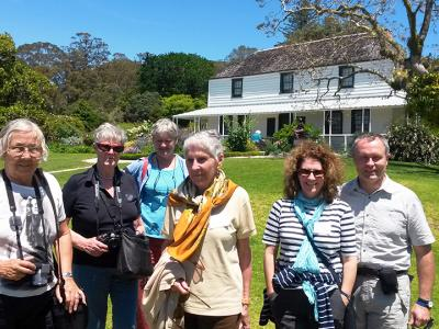 Small group outside historic Kemp house in Kerikeri