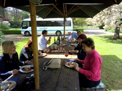 MoaTrek group tasting wine at lunch, Akaunui Homestead Canterbury NZ
