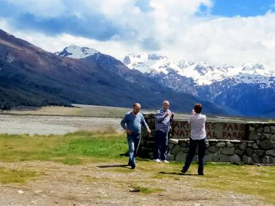 Photo stop at the Arthur's Pass National Park sign - MoaTrek NZ Tours