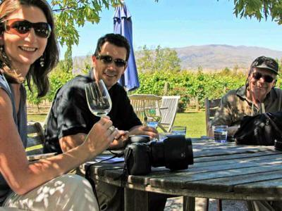 Tasting wine in the shade of the trees, Queenstown