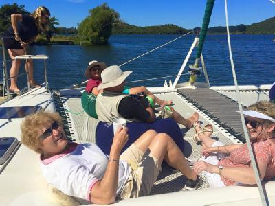 Guests relaxing on the yacht, Lake Rotoiti