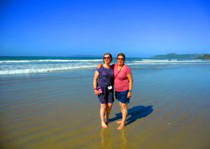 Ladies relaxing on the beach in New Zealand - Tour Review
