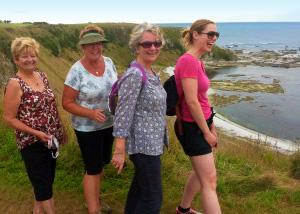 MoaTrek women spending enjoyable time on the coast - Tour Review