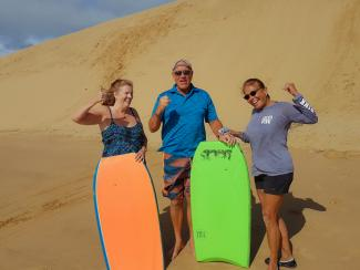 Happy sandboarders in the Hokianga
